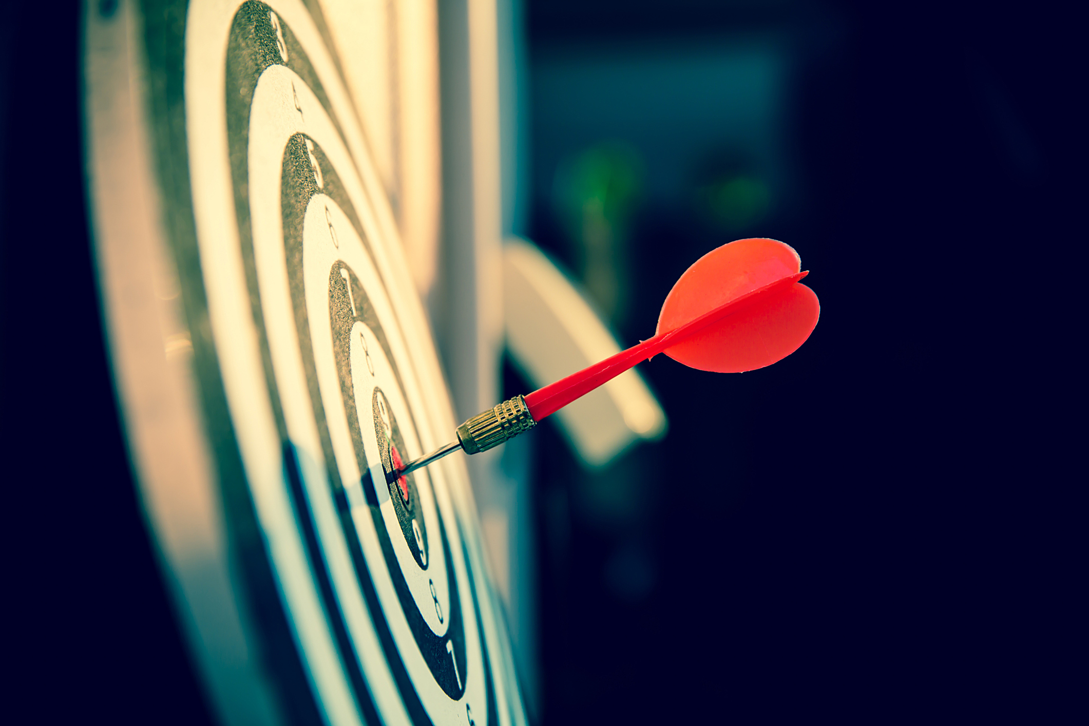 lose up a red color arrow in the center of Bullseye or bull's-eye for business targeting and good success.