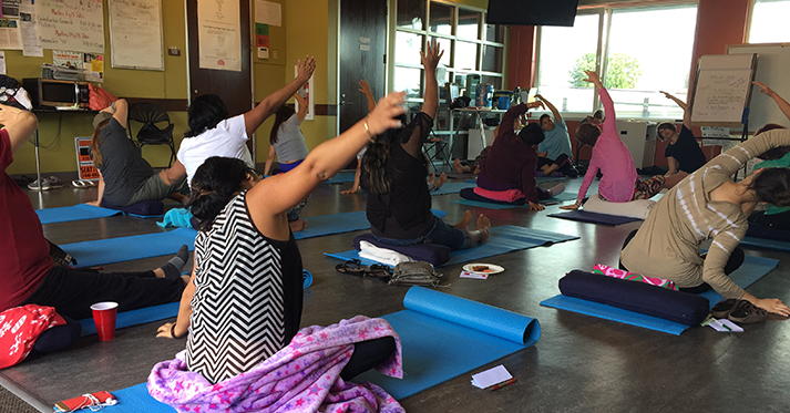 ALMA participants practice yoga at Casa Latina.