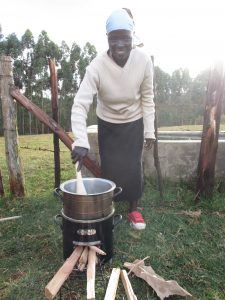 A woman in Kenya tests a more efficient cookstove developed by UW mechanical engineers and BURN Manufacturing.