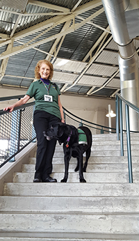 Dr. Jill Robinson and therapy dog Sydney from HOPE Animal-Assisted Crisis Response helped calm both patients and volunteers.