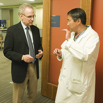 Dr. Stanley Herring (left), rehabilitation, sports and orthopedic medicine, and Dr. Fangyi Zhang (right), neurosurgery and spine injury, at Harborview Medical Center.