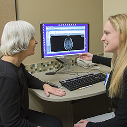 Dr. Shana Johnson, rehabilitation medicine, reviewing images with a patient at the UW Medicine Multiple Sclerosis Center at Northwest Hospital & Medical Center.